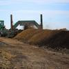 Turning compost at the Chamness Technology Dodge City location.