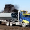 Chamness Technology Semi Truck and Side Dump Trailer being loaded with finished compost for delivery.