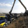 Chamness Technology Long Reach Back Hoe, used for pulling material from lagoons and loading onto trailers.